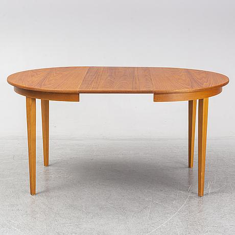 A second half of the 20th century teak veneered dining table.