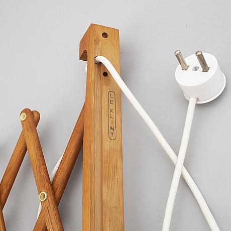 Two le klint wooden wall lamps.
