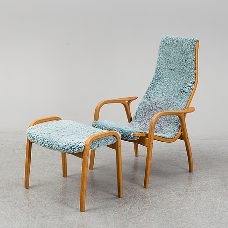 Yngve ekstrÖm, a 'lamino' armchair with a stool, swedese.