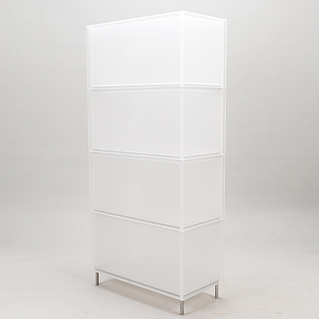 "Four pieces of kartell ""one"" modular storage systems by piero lissoni/patricia urquiola."