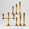 Six candlesticks and one candelabra, gusum goproduct as, brass.