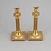 A pair of skultuna brass candle sticks.