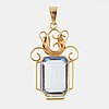 Blue synthetic spinel and 18k gold pendant.