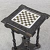 A porcelain and wooden mounted chess table, late 19th century.