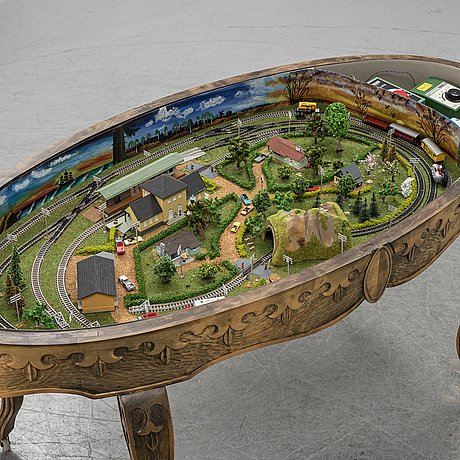 A table with a mini-trix modeltrain inside.