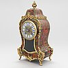 A french boulle style mantel clock, late 19th century.