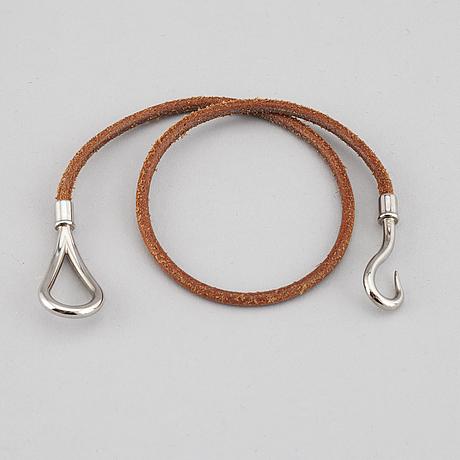 HermÈs, a 'jumbo double tour' bracelet.