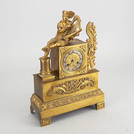 An 19th century empire mantel clock.