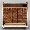A circa 1900 chest of 20 drawers.