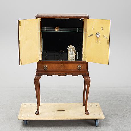 A mid 20th century walnut veneered bar cabinet.