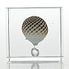 Oiva toikka, an annual glass cube, signed oiva toikka nuutajärvi 2009 and numbered 22/2000.