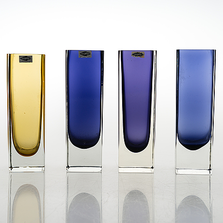 Kaj franck, a set of four glass vases. signed nuutajärvi notsjö.