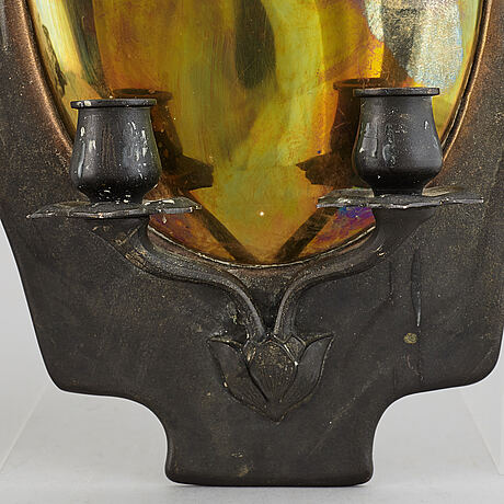 A pair of bronze and brass wall sconces from the early 20th century.