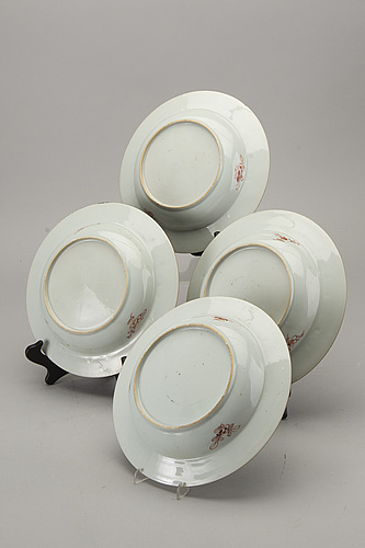 A set of four chinese famille rose qianlong porcelain plates.