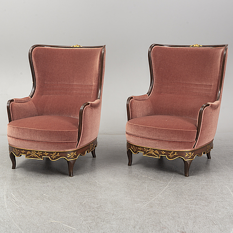 A pair of 1930s easy chairs.