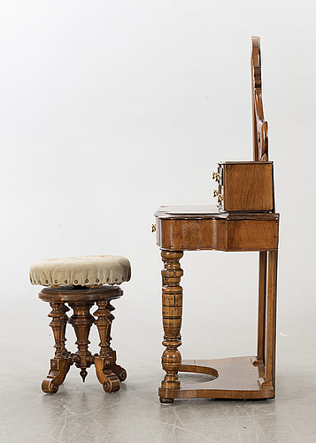 A second half of the 19th century table with mirror and a stool.