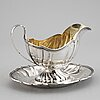 A parcel gilt rococo style sauce boat, maker's mark david andersen & co, stockholm, 1911.