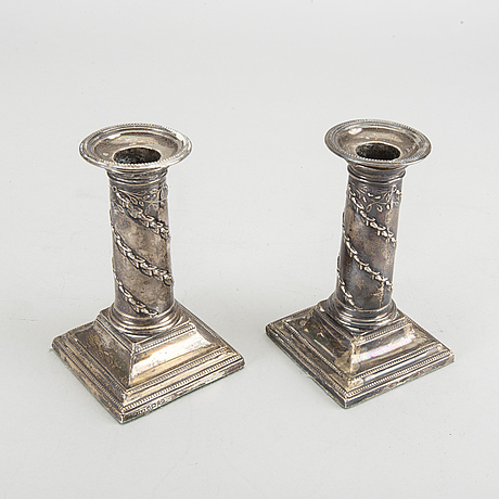 Hawksworth, eyre & co ltd a pair of silver candlesticks.