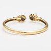 Rannekoru, 14k kultaa, timantteja n. 0.24 ct yht ja rubiineja.