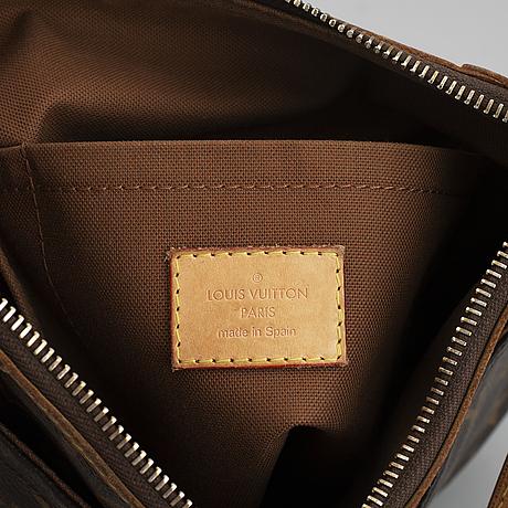 "Louis vuitton, an ""odek pm"" handbag."