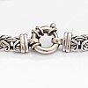 A 14k white gold bracelet.