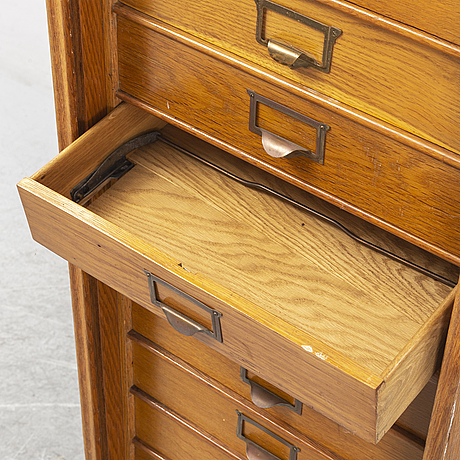 An oak file cabinet, first half of the 20th century.