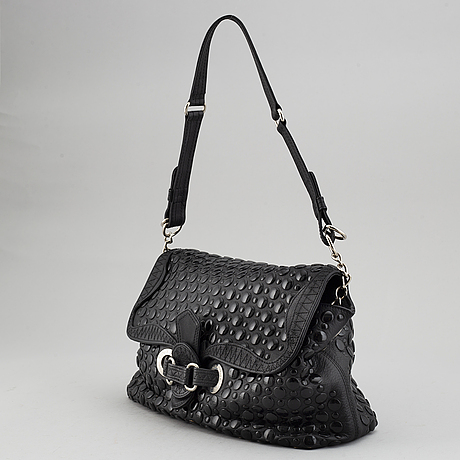Sonia rykiel, a black leather bag.