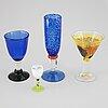 Kjell engman, ulrica hydman vallien, a mixed lot of four glass objects, kosta boda, sweden.