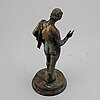 A 20th century bronze sculpture of narcissus.