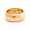 Ring 18k gold, 7 brilliant-cut diamonds approx 0,50 ct in total, width approx 9 mm, 15,4 g.