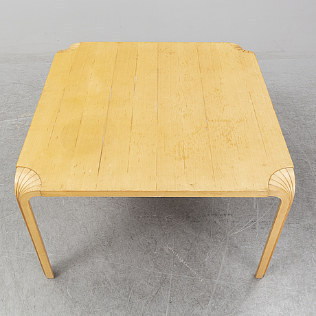 "An alvar aalto "" fan leg table"" table."