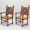 A pair of c. 1900 open armchairs.