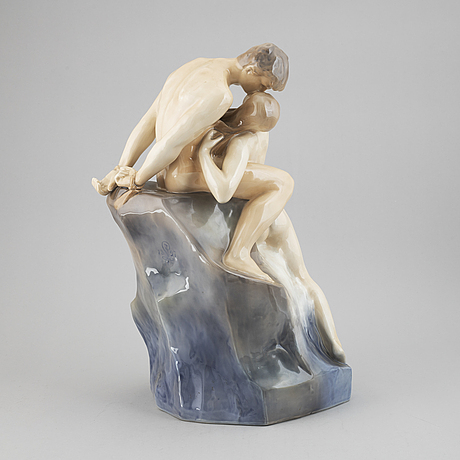 Royal copenhagen, a porcelain figure group, 'kyssen'.