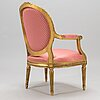 A armchair in gustavian style from early 20th century.