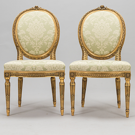 A pair of chairs in gustavian style from early 20th century.