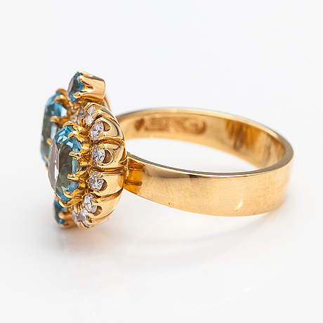 "An 18k gold ring ""sophia albertina"" with topazes and diamonds ca. 0.72 ct in total. ofelia jewelry, helsinki 1998."