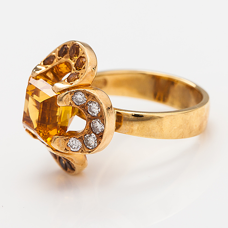 "An 18k gold ring ""catherine jagiellon"" with citrines and ca 0.37 ct of diamonds. ofelia jewelry, helsinki 1998."