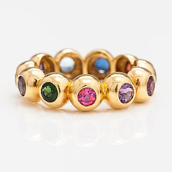 An 18K gold ring with different gemstones. Ofelia Jewelry, Helsinki.