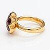 "An 18k gold ring ""gingerbread"" with rodolite garnets. ofelia jewelry, helsinki."