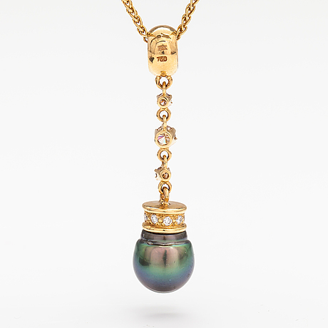 A 14k and 18k gold necklace with a tahiti pearl and diamonds ca. 0.72 ct in total. ofelia jewelry, helsinki.