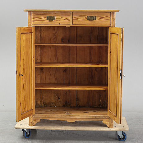 An early 20th century pine cupboard.