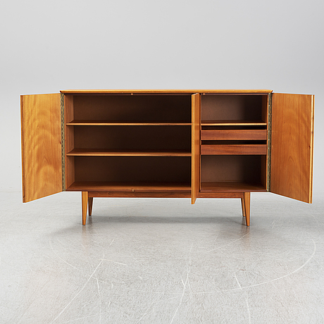 A mid 20th century teak veneered sideboard.