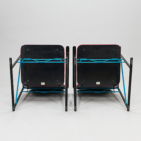 A pair of 1980s a500-series armchairs and an ottoman by yrjö kukkapuro, avarte, finland.