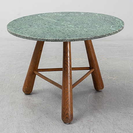 A late 20th century stone and wood coffee table.