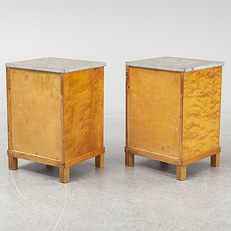 A pair of 1930s bedside tables.