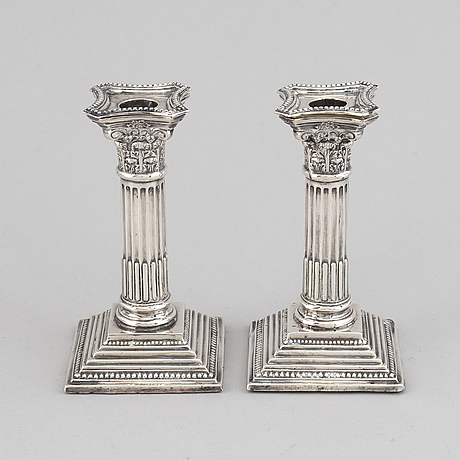 A pair of silver candle sticks, england.