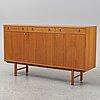 A 1950s/1960s teak veneered sideboard.