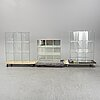 Three glass bookcases, late 20th century.