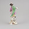 A porcelain figurine, with a meissen like mark, second half of the 20th century.