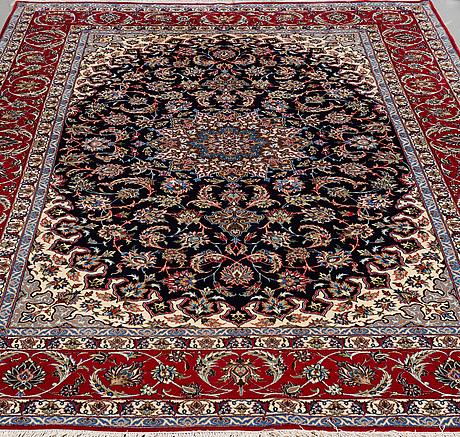 A carpet, old esfahan, part silk, ca 306,5 x 201 cm.